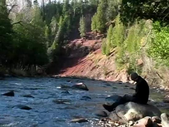man praying beside river motion background motion